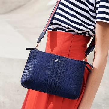 Blue clutch with sporty carrying strap. #paulsboutique #designer #fashionitem #musthave