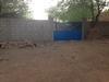 Poort in de muur van Aribinda